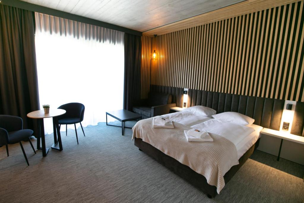 Łóżko lub łóżka w pokoju w obiekcie Śnieżynka