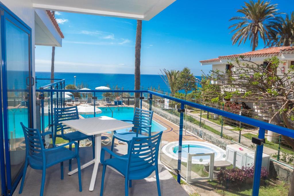 Uitzicht op het zwembad bij Alsol Los Caribes 1 of in de buurt