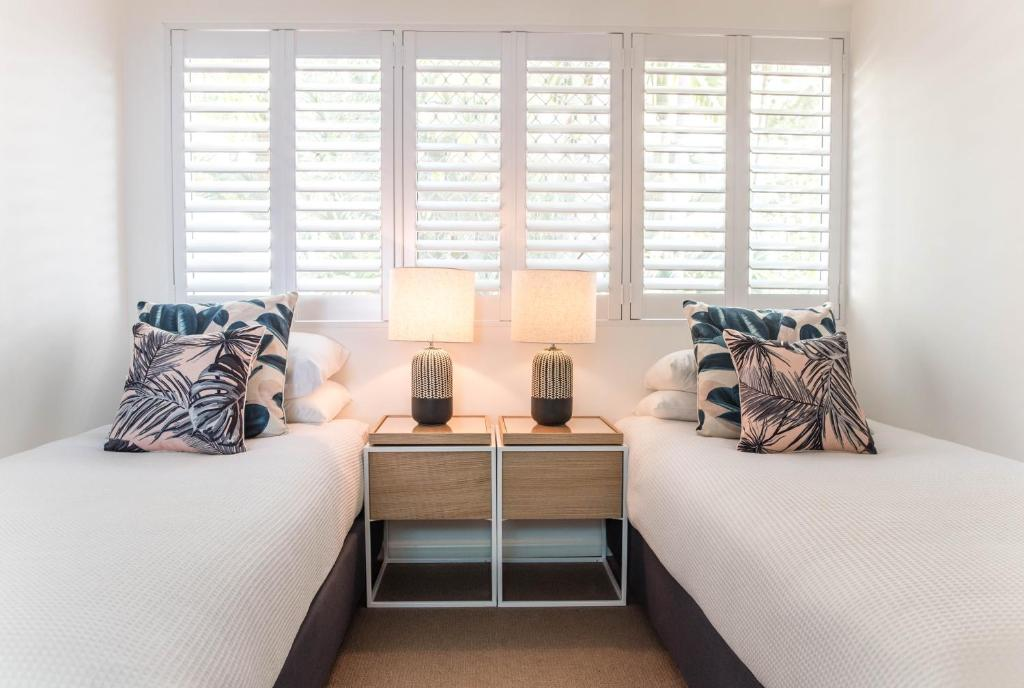 A bed or beds in a room at Noosa Crest Resort