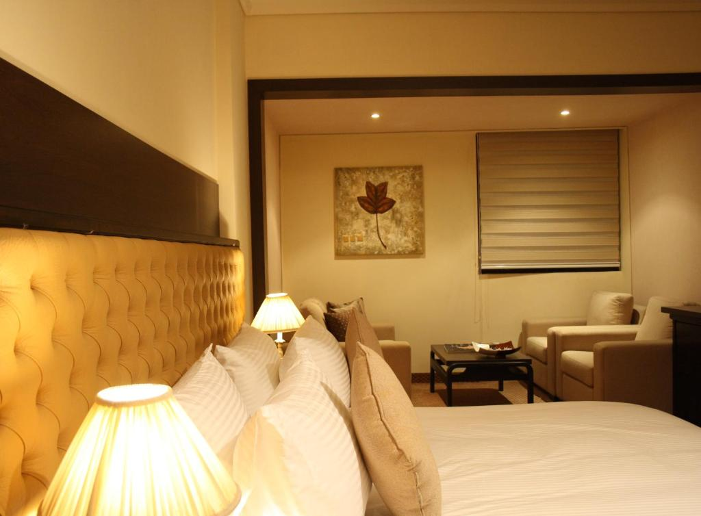 A bed or beds in a room at Grand Hotel Beirut