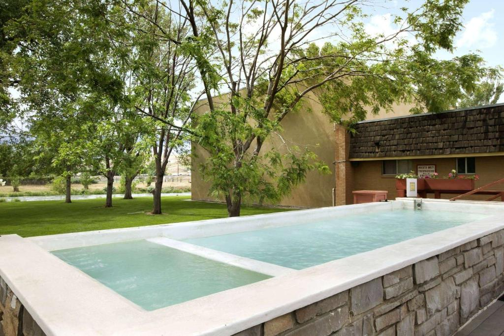 The swimming pool at or near Days Inn by Wyndham Thermopolis