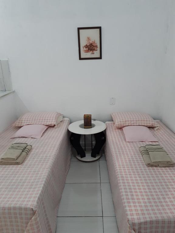 A bed or beds in a room at Kitnet Aconchegante Em Benfica