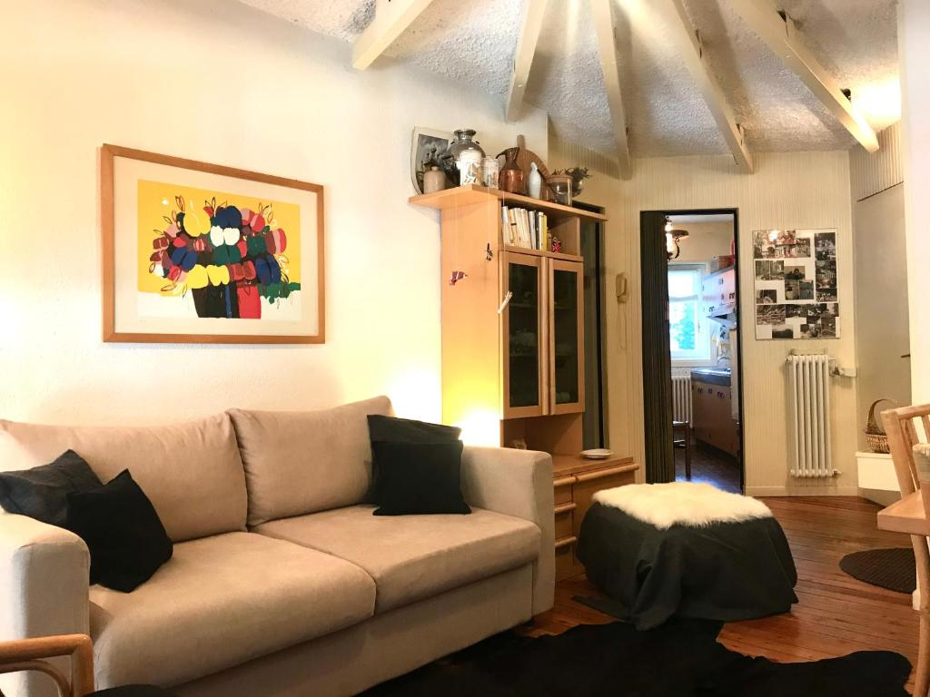 A seating area at Appartamento Lago Azzurro Madesimo