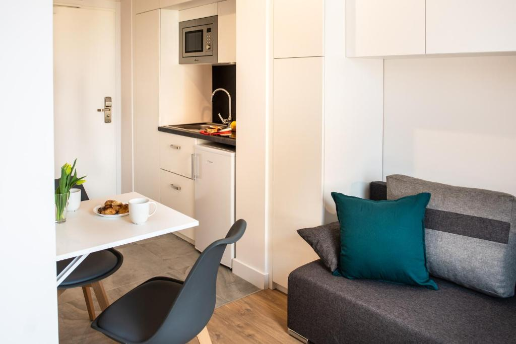 A seating area at Apartamenty Olimpijskie