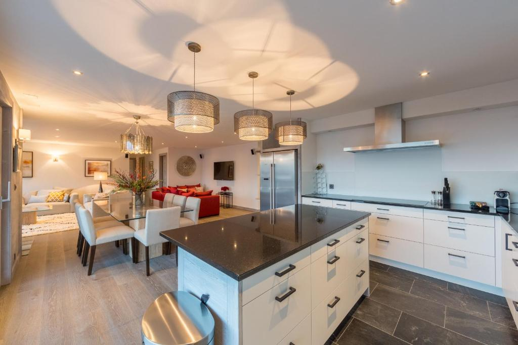 A kitchen or kitchenette at Apartment La Forêt 2 - Spa access