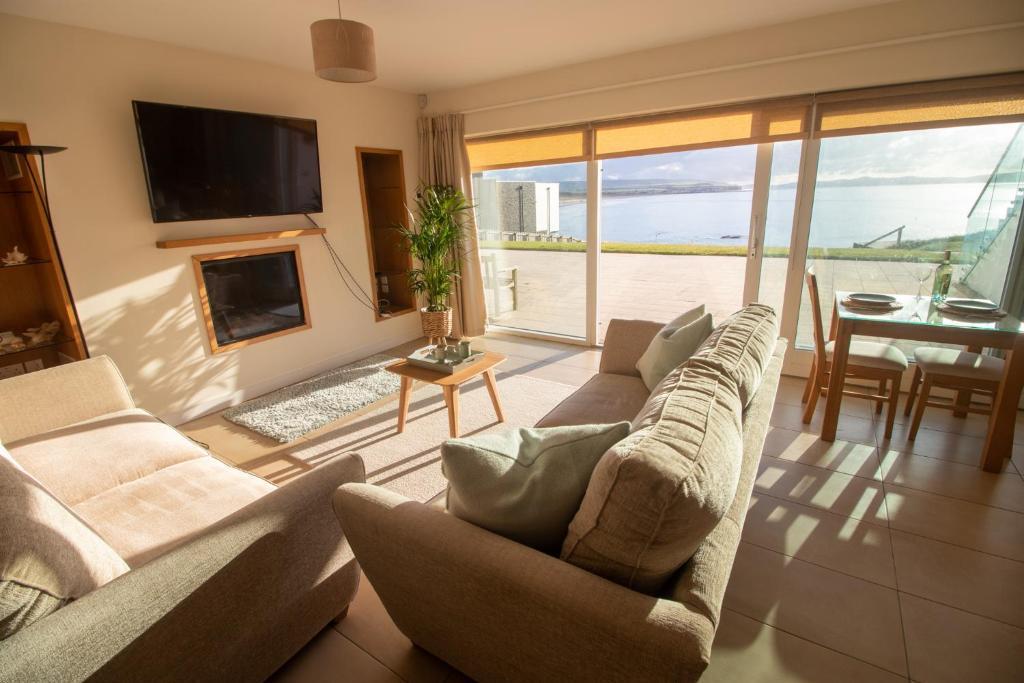 Area soggiorno di At The Beach Rooms