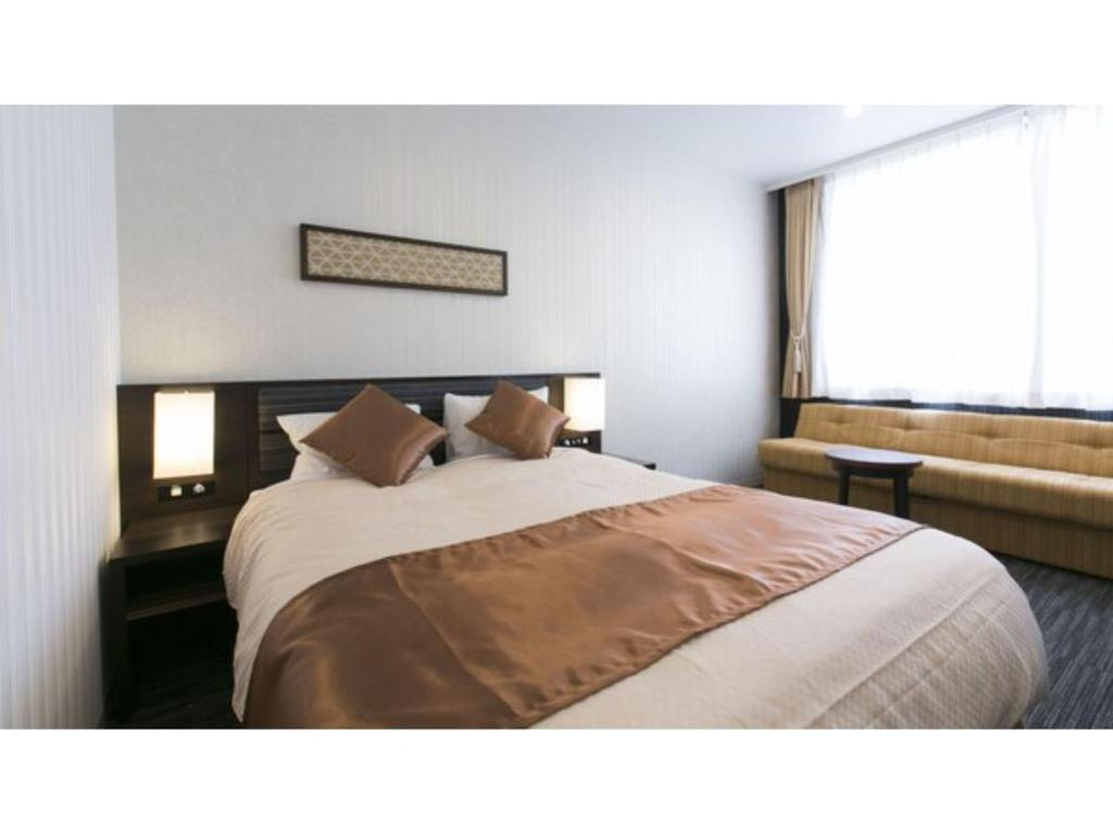 A bed or beds in a room at Hotel Seiyoken - Vacation STAY 39577v