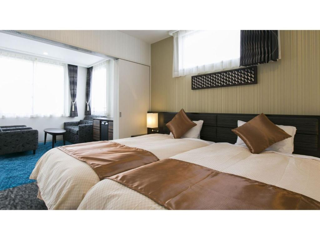 A bed or beds in a room at Hotel Seiyoken - Vacation STAY 39585v