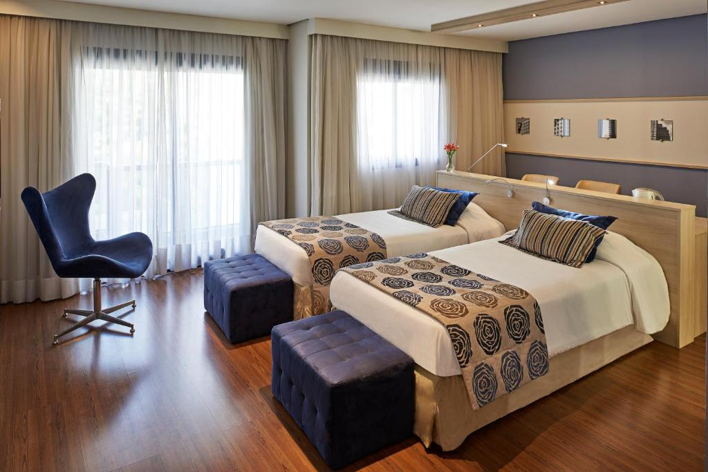 A bed or beds in a room at Mercure Sao Paulo Pamplona