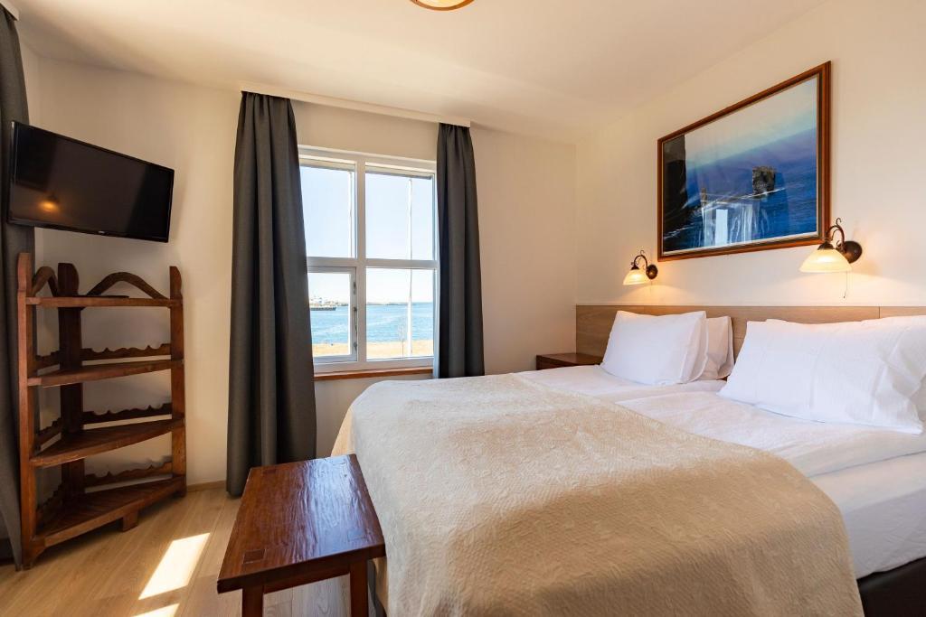 Кровать или кровати в номере Hotel Viking