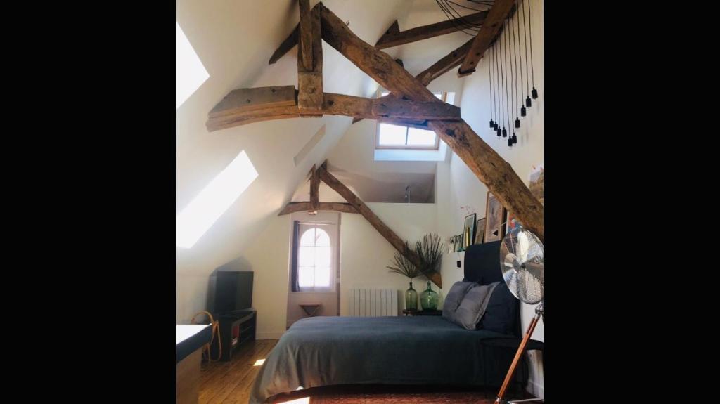 Un ou plusieurs lits dans un hébergement de l'établissement La Tour Bayeux