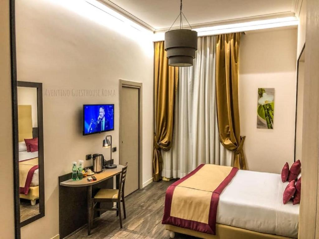 A television and/or entertainment center at Aventino Guest House