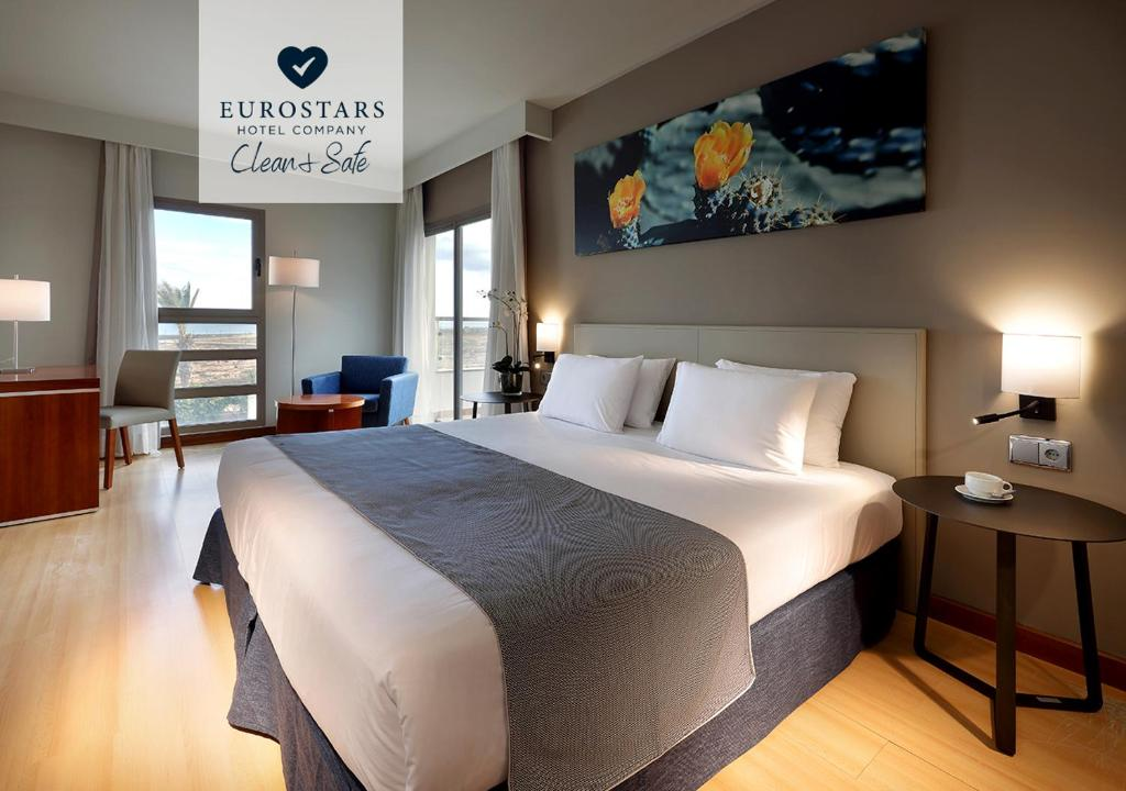 A bed or beds in a room at Eurostars Las Salinas
