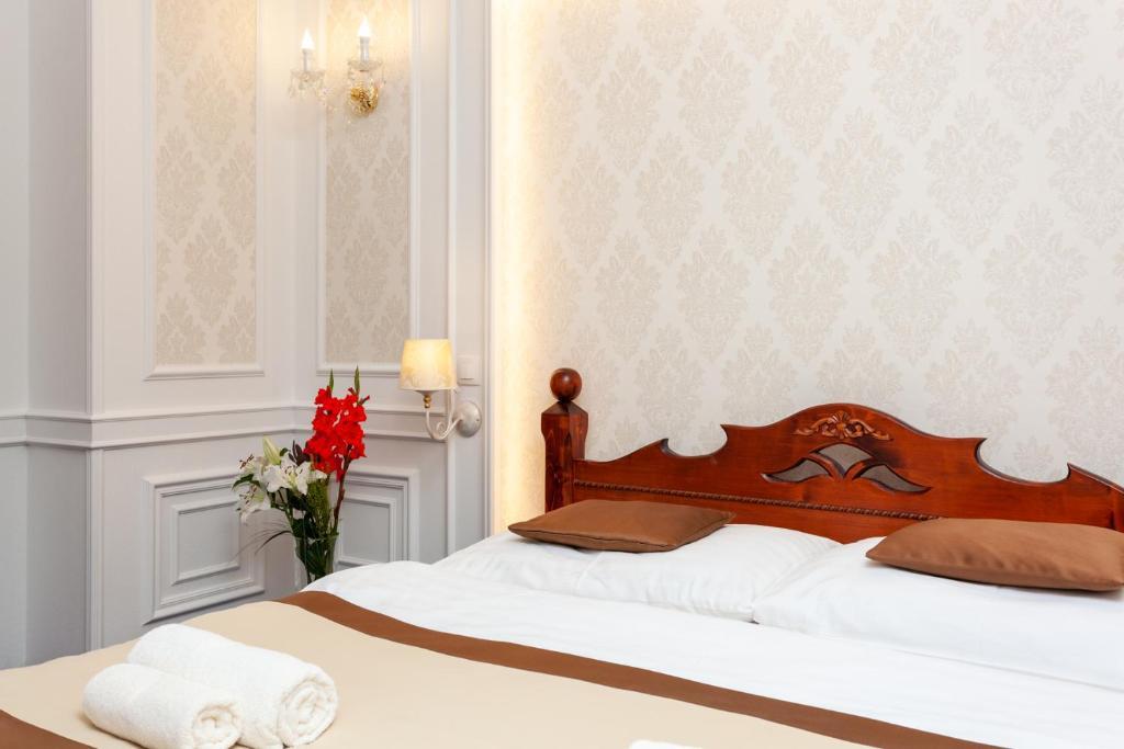 A bed or beds in a room at Penzión Budzák