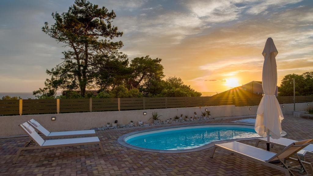 The swimming pool at or near Arktos Sunset Villa