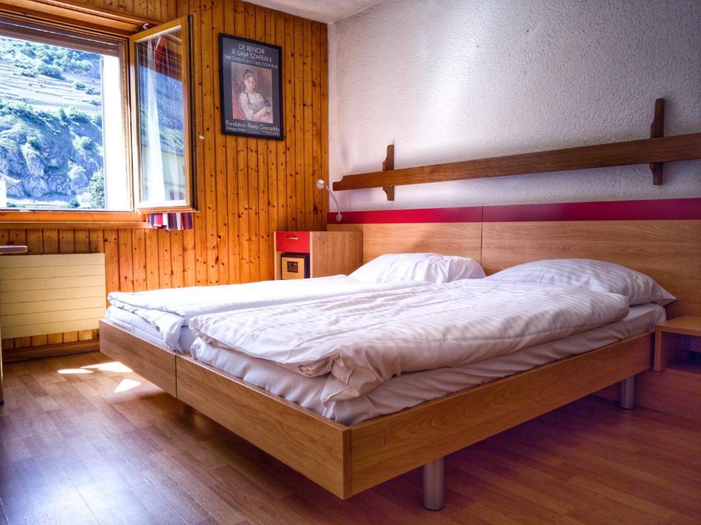 Un ou plusieurs lits dans un hébergement de l'établissement Hotel du Stand