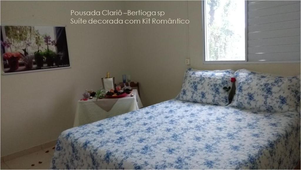 Cama ou camas em um quarto em Pousada Clariô