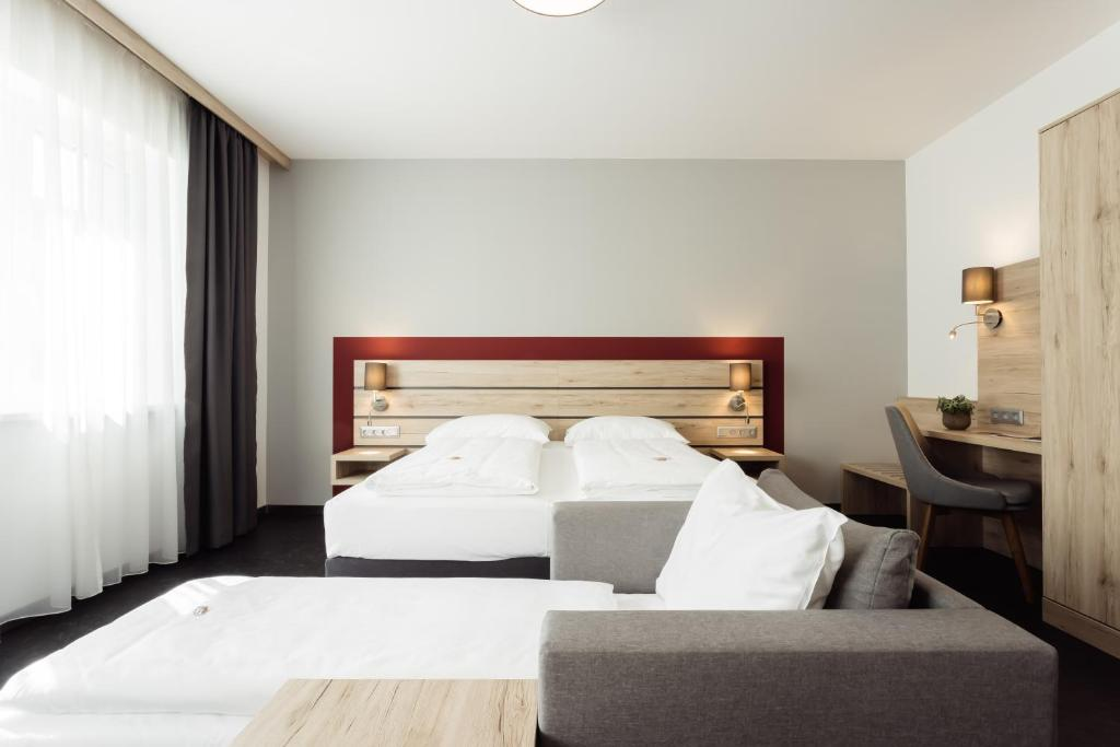 A bed or beds in a room at Hotel Smart Liv'in