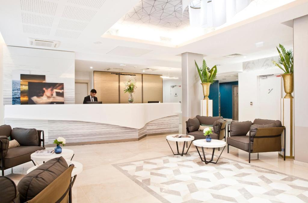 The lobby or reception area at Residhome Marseille