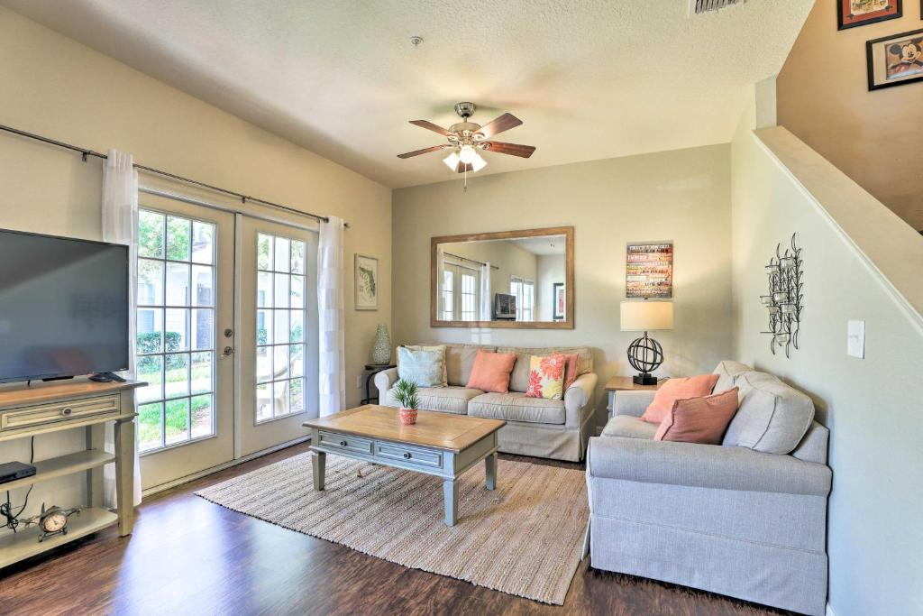 A seating area at Lucaya Village Townhome with Pool, 6 Mi to WDW!
