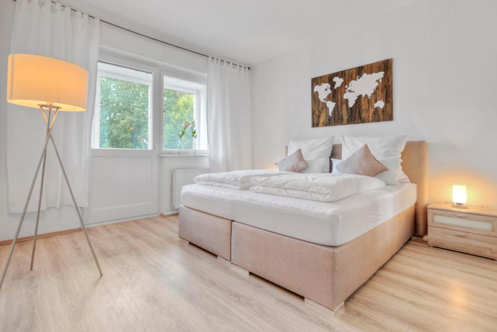"""A bed or beds in a room at Apartment """"Am Sternbuschweg"""""""