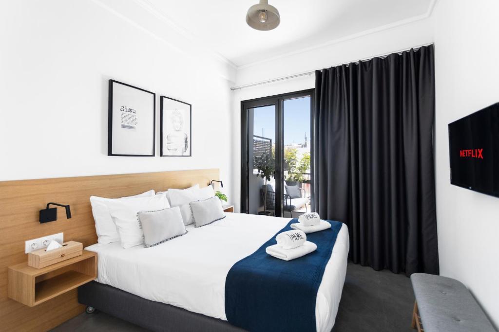 מיטה או מיטות בחדר ב-PAME House