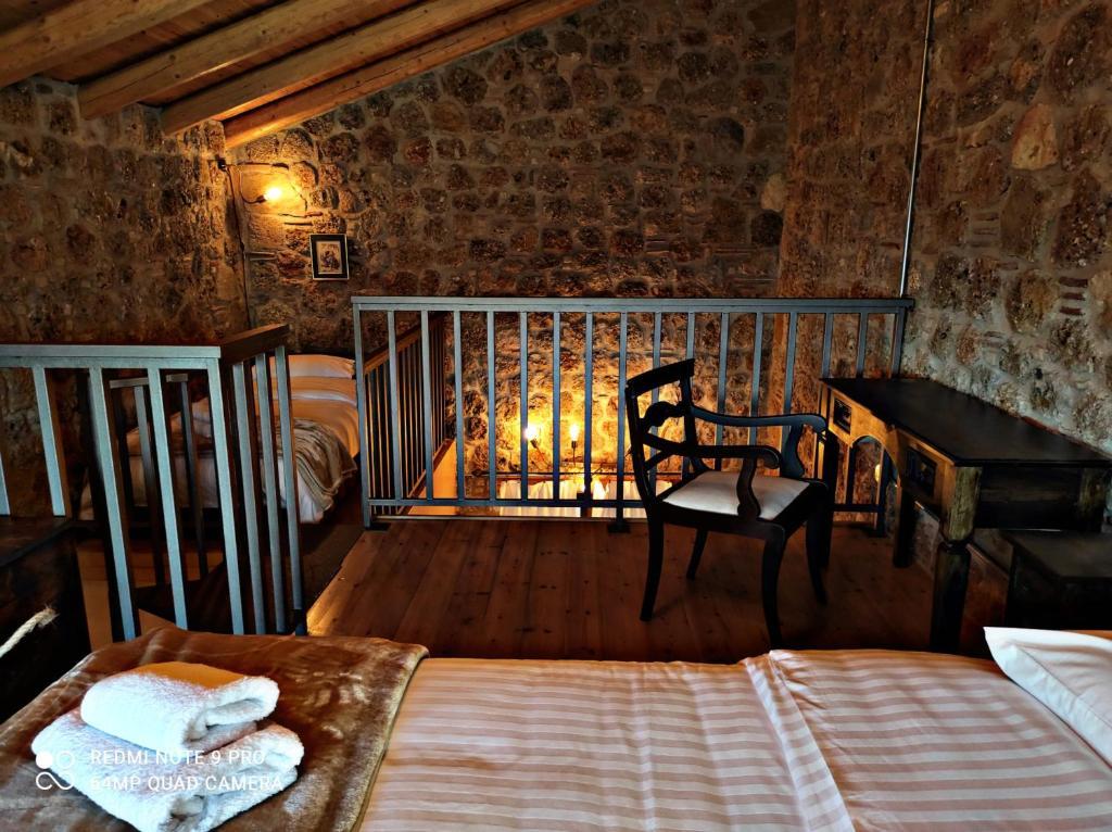 Ένα ή περισσότερα κρεβάτια σε δωμάτιο στο Αγγελικά στα ορεινά