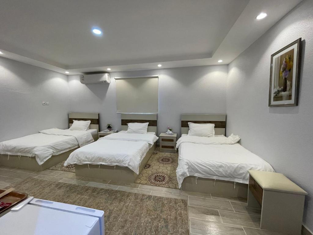Cama ou camas em um quarto em Naseem Al Atheeb Country House