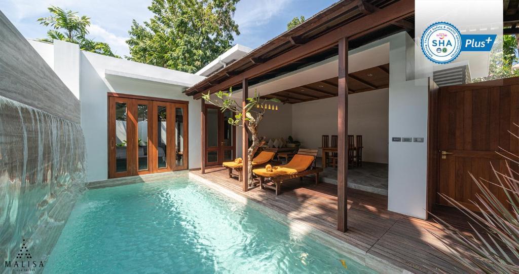 The swimming pool at or near Malisa Villa's Kata