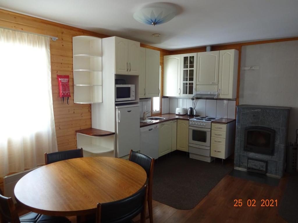A kitchen or kitchenette at Yyterin Villa Pyrylä