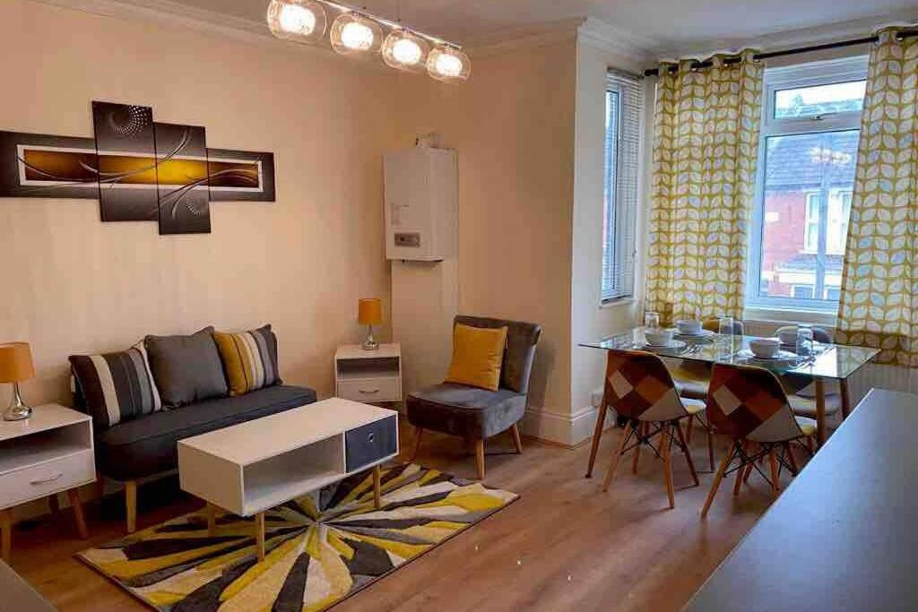 A seating area at Excellent and very Modern Apartment with Private Parking