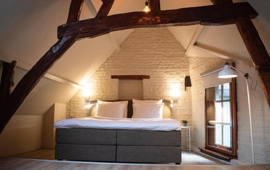 A bed or beds in a room at 4BnB Maastricht