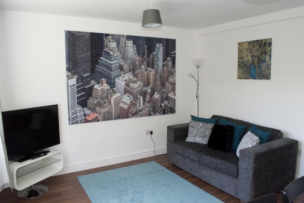 A television and/or entertainment center at Ground floor apartments with secure parking near Hinckley Centre perfect for contractors or visitors to the area!