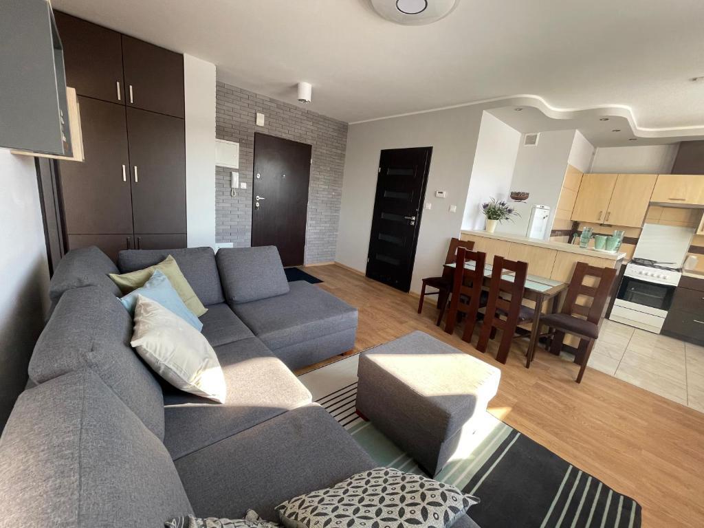 Część wypoczynkowa w obiekcie Komfortowe studio 52 m2 w centrum Grójca