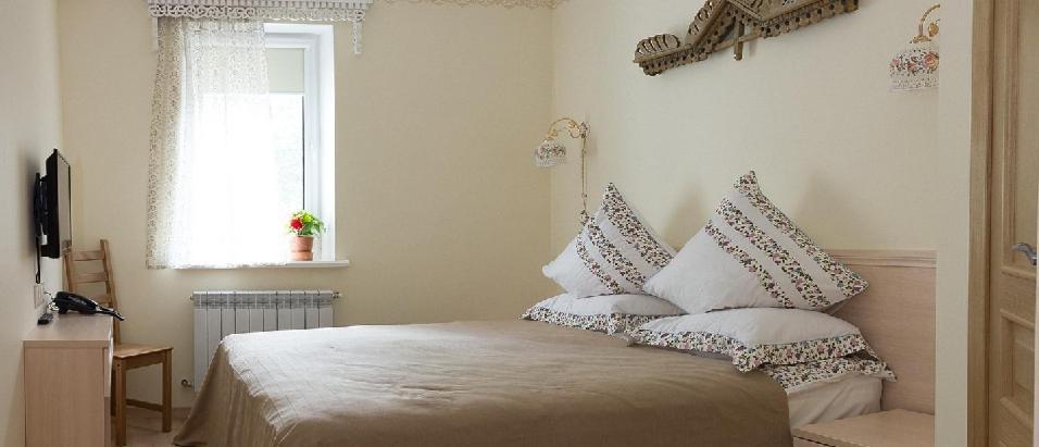 A bed or beds in a room at Gostevaya Izba Na Istre