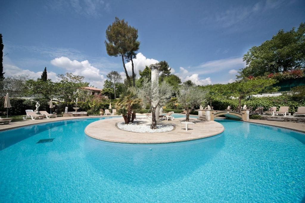 The swimming pool at or near Hotel Les Messugues