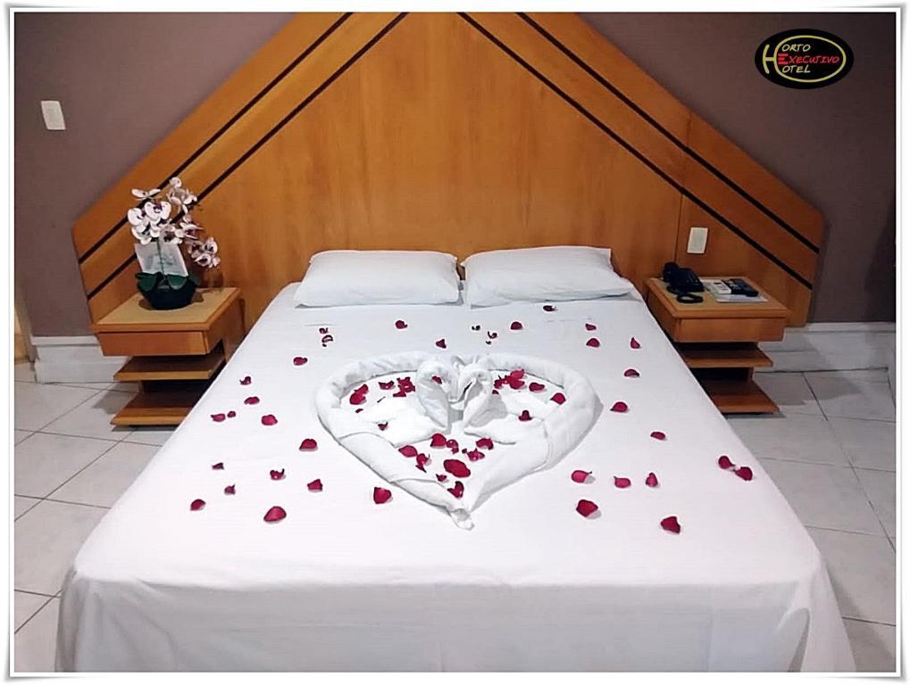Кровать или кровати в номере Horto Executivo Hotel