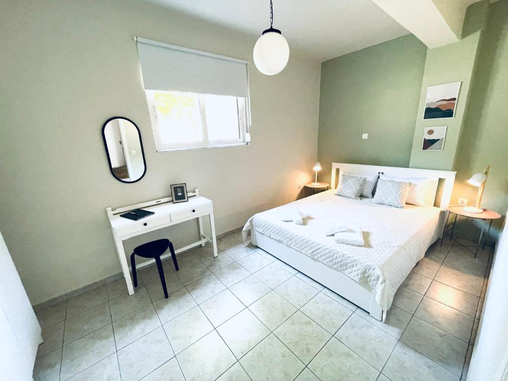 A bed or beds in a room at Sofi's Apartments