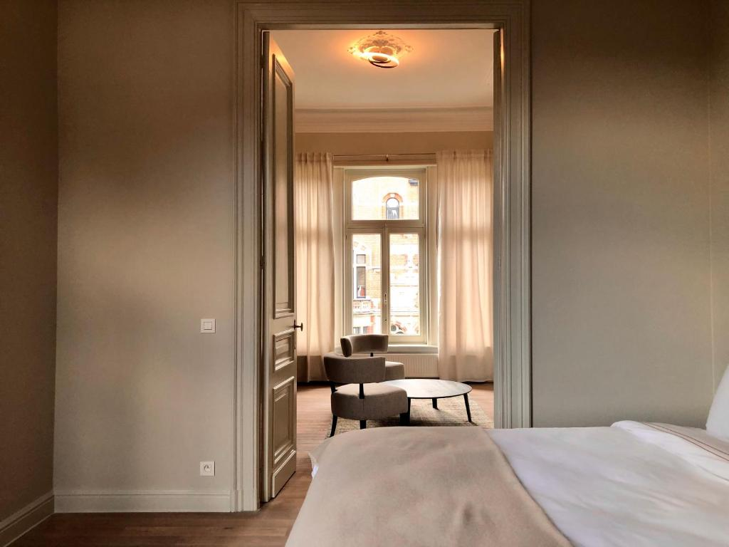 A bed or beds in a room at The Scent Residence