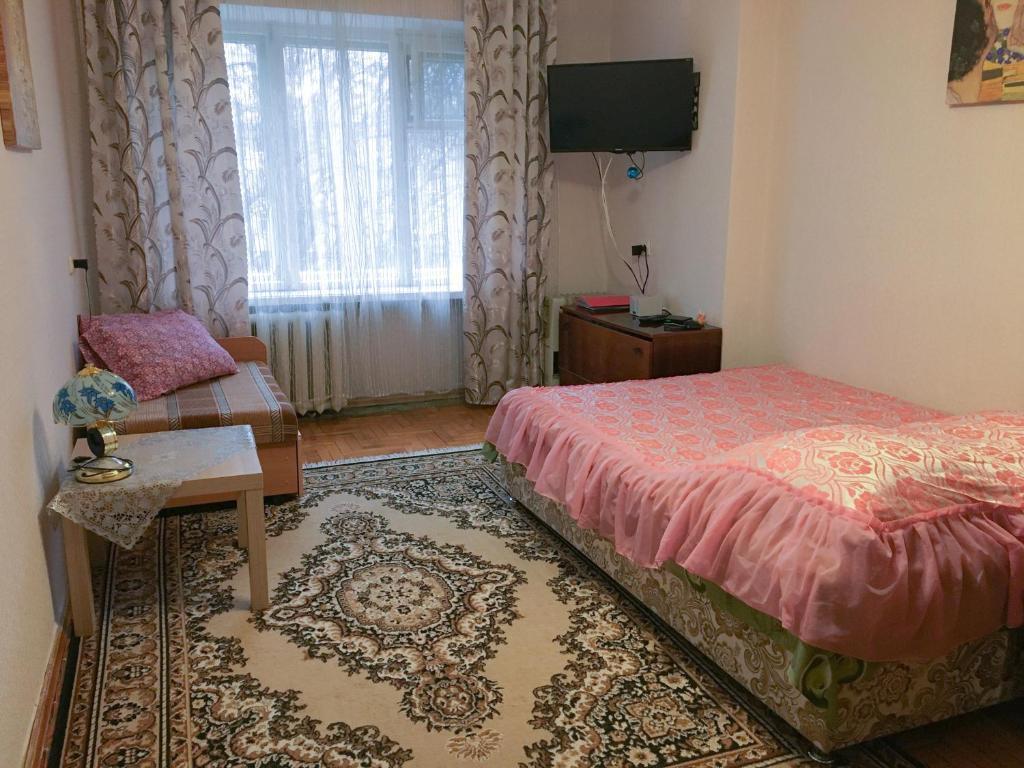 Кровать или кровати в номере Apartments 8 marta