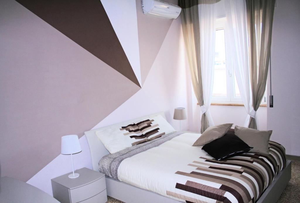 A bed or beds in a room at Casa di Giulia