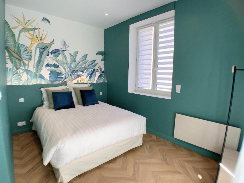 Un ou plusieurs lits dans un hébergement de l'établissement Appartement de 60 m2 tout juste rénové à Saint Malo Intra-Muros