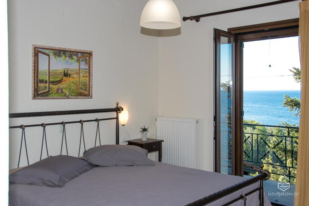 Ένα ή περισσότερα κρεβάτια σε δωμάτιο στο Pantheon Apartments
