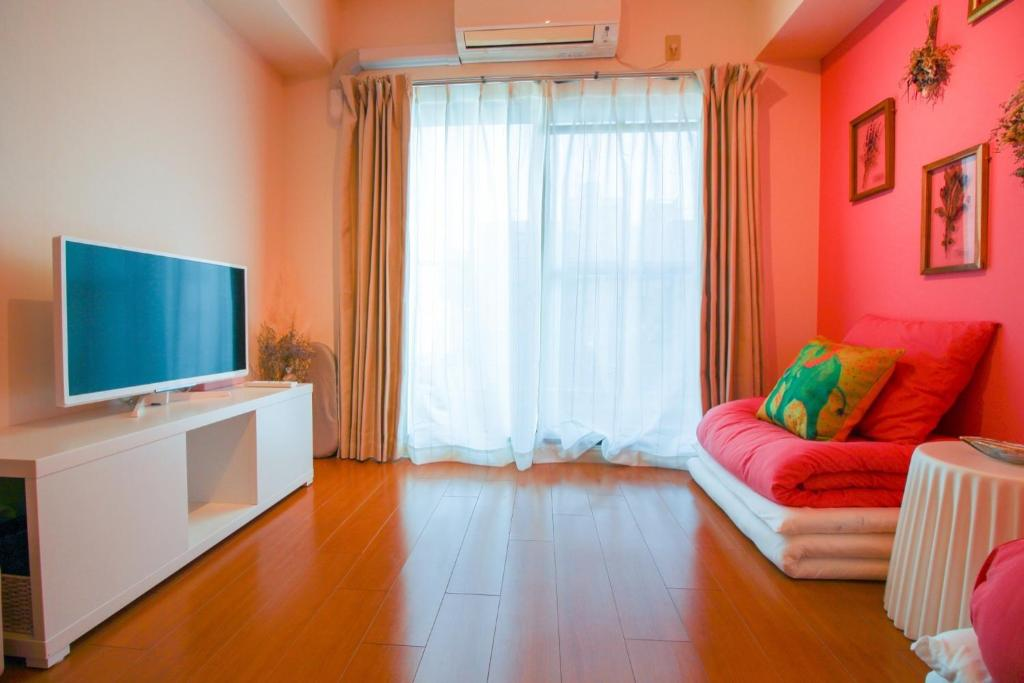 A television and/or entertainment centre at Sunplaza 126 Shimanouchi - Vacation STAY 42941v