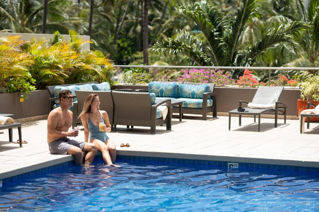 The swimming pool at or near DoubleTree by Hilton Alana - Waikiki Beach