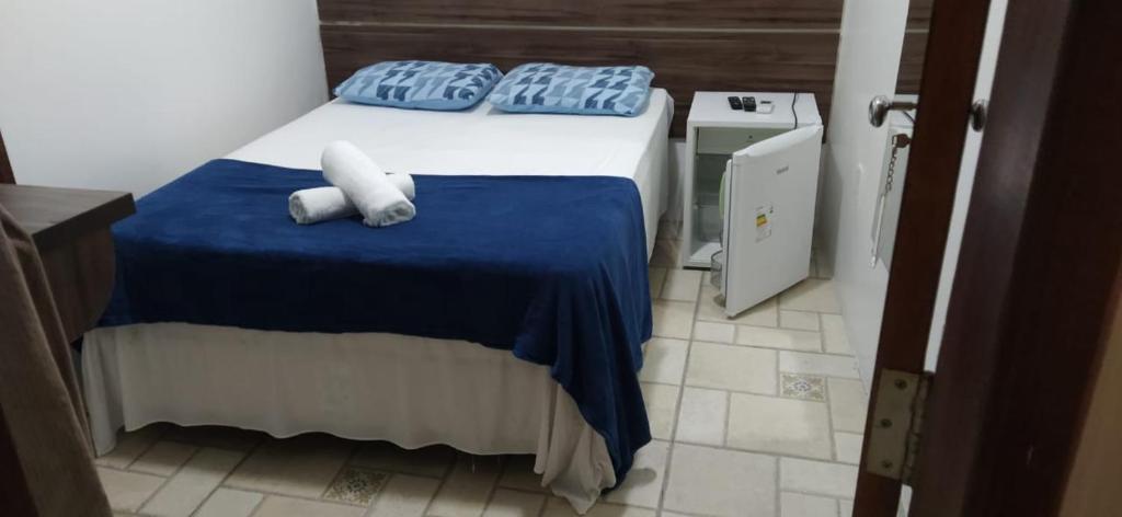 A bed or beds in a room at Pousada Barrancas
