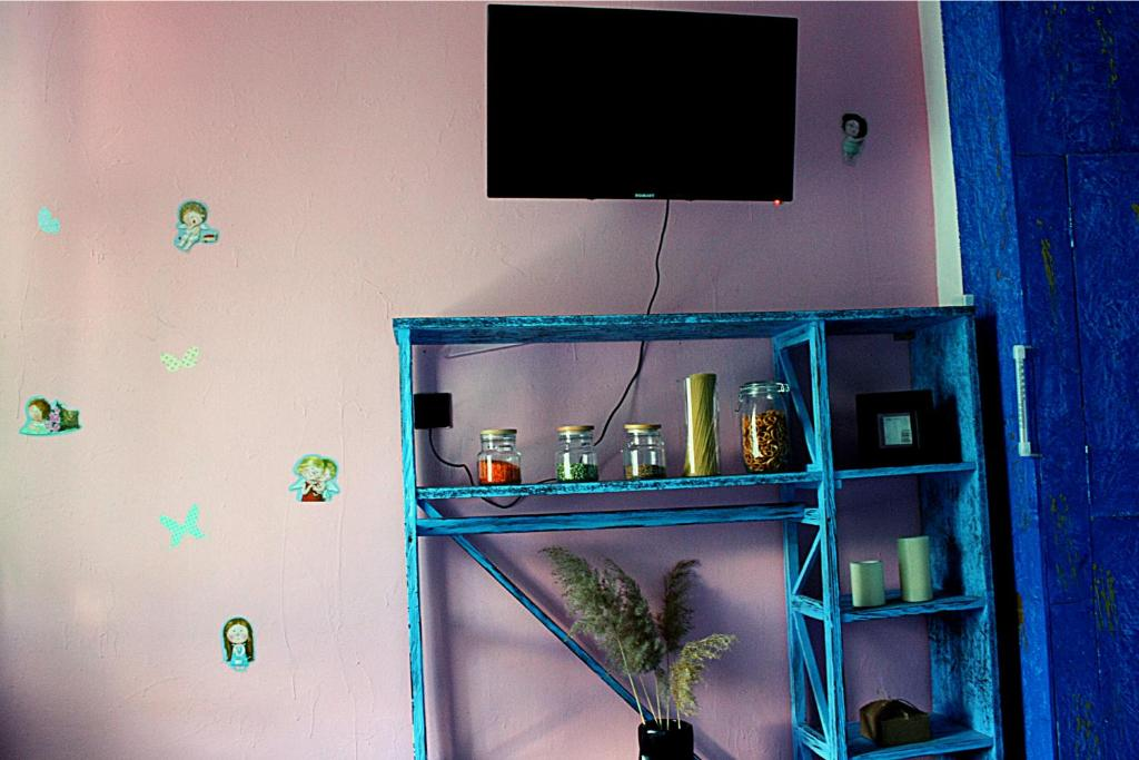 """A television and/or entertainment center at Apartment on Sumskaya 46 """"Family"""""""