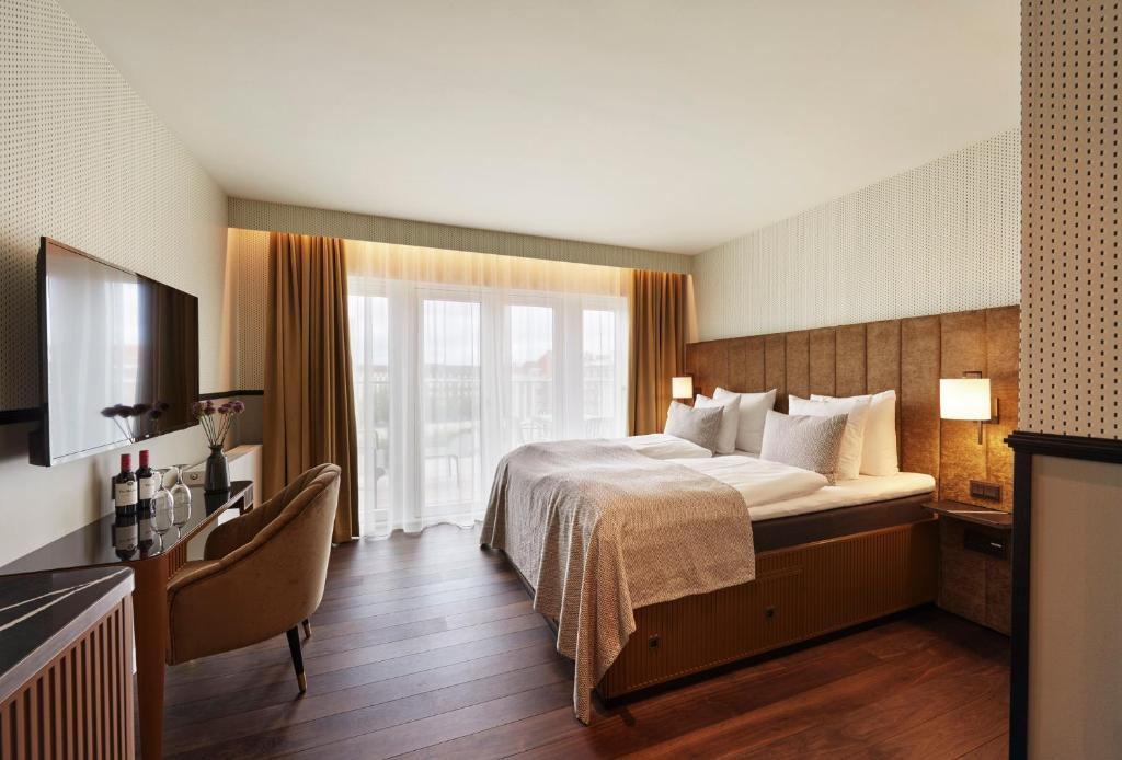 A bed or beds in a room at WIDE Hotel