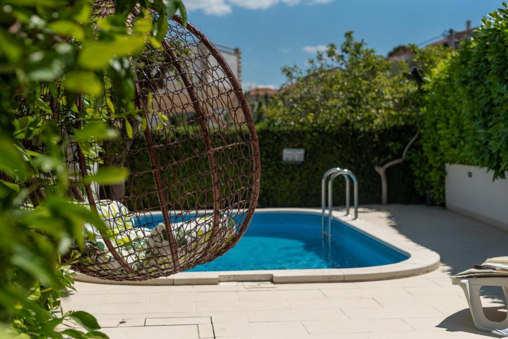 The swimming pool at or close to Apartments Orlic