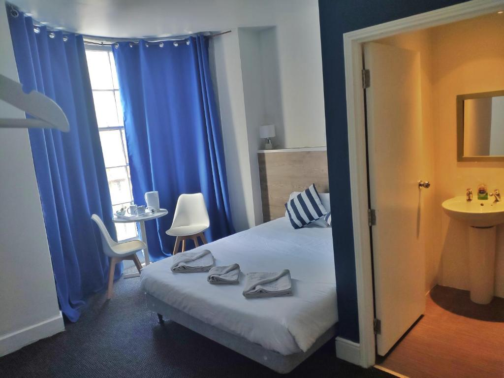 A bed or beds in a room at Number 75